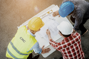 3 construction workers looking at plans
