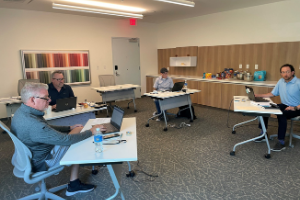 Four people in a conference room